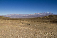 Dry river and far mountain Royalty Free Stock Photography