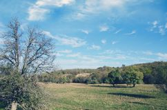 Dry river floodplain against the background of clouds Royalty Free Stock Photo