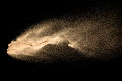 Dry river sand explosion isolated on black background. Abstract sand cloud.Brown colored sand splash against dark background.  royalty free stock photo