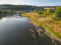 Dry riverbed of river Elbe in Decin, Czech Republic. Castle above old railway bridge. Dry riverbed of river Elbe in Decin, Czech Republic, summer 2018. Empty stock images