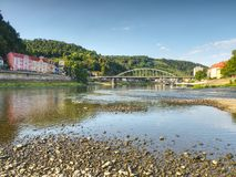 Dry riverbed of river Elbe in Decin, Czech Republic. Castle above old railway bridge. Dry riverbed of river Elbe in Decin, Czech Republic, summer 2018. Empty royalty free stock photography