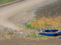 A Dry Riverbed at time of Famine in Hot Summer. In many areas, a hot summer is associated with drying out of rivers and famine... This is one such photograph of Royalty Free Stock Photography
