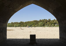 Dry riverbed. View of dried Zayandeh rood river from Siosepol bridge vault, Isfahan, Iran Royalty Free Stock Image