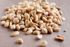 Dry Roasted Peanuts. A pile of peanuts on a neutral surface Royalty Free Stock Photography