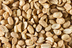 Dry roasted peanuts. scattered to make background or texture. Ma Stock Image