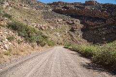 Dry and rocky gravel road royalty free stock image