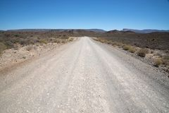 Dry and rocky gravel road Stock Photos