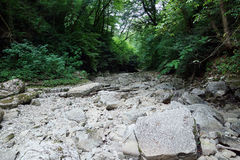 Dry rocky riverbed of the river Royalty Free Stock Photo