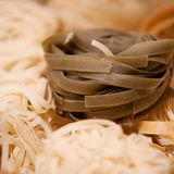 Dry rolled noodles. Dry twisted noodles for cooking Royalty Free Stock Photo