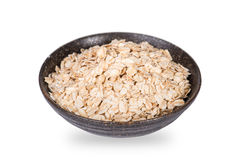 Dry rolled oat flakes oatmeal in bowl Royalty Free Stock Photos