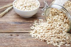 Dry rolled oat flakes oatmeal stock image