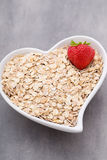 Dry rolled oatmeal in bowl. Stock Images