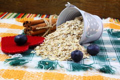 Dry rolled oatmeal flakes  in heart bucket with blueberry cinnamon and heart Stock Photo