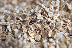 Dry rolled pile of oats. Closeup deep blur and bokeh Stock Photography