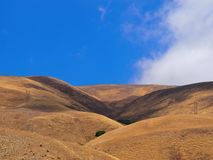Dry Rolling Hills with Blue Sky Contrast Royalty Free Stock Photos