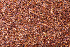 Dry rooibos tea leaves as texture for background.  Royalty Free Stock Image
