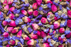 Dry rose buds and forget me not flowers, healthy herbal tea Stock Photos