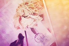 Dry rose and old postcard with handwritten. Lens flare and bokeh Stock Photography