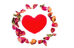 dry rose petals and red heart stock photo