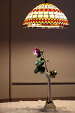 Dry rose under light. One dried rose in glass vase under pendant light Royalty Free Stock Photo