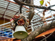 Dry roses and heart wind bell Royalty Free Stock Photography
