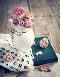 Dry roses and old book. Stock Images