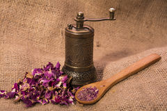 Dry roses powder. Dry roses with dry roses powder and grinder Royalty Free Stock Photo