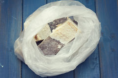 Dry salted cod fish in plastic bag Stock Images