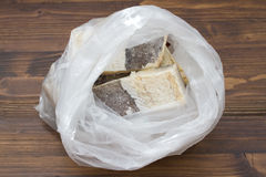 Dry salted cod fish in plastic bag Royalty Free Stock Photo