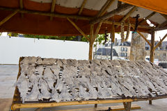 Dry salted fishes stand. Drying salted fish in the traditional way in open air, in Vannes, Brittany, France. Basque and french cultural exchange Royalty Free Stock Photography