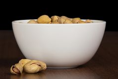 Dry salted pistachio in bowl Royalty Free Stock Photo