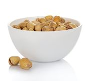 Dry salted pistachio fruit in bowl Royalty Free Stock Photos
