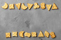 Dry salty cracker cookies on gray stone background stock photo