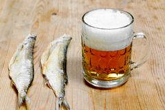 Dry salty fish and beer Royalty Free Stock Photos
