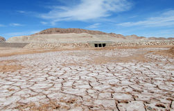 Dry salty soil pattern in San Pedro de Atacama desert. Panoramic view of empty dry solty desert soil in SanPedro de Atacama. Red rocks in driest area in the Stock Photography