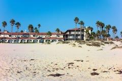 Dry Sand and  Palms around Beach Resort Stock Images
