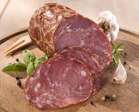 Dry sausage. Tasty sliced dry sausage with spices Stock Photo