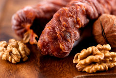 Dry sausages with walnuts Stock Photography