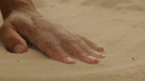 Dry sea sand on a woman`s hand stock footage