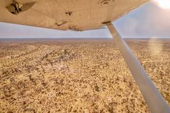 The dry season in Botswana, as seen from a small plane. Shot from a small safari charter plane, showing a panoramic view of a parched and barren Botswana royalty free stock photography