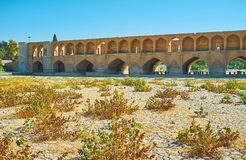 The dry season in Isfahan, Iran. Dry season in Isfahan is the best time to walk along the bottom of Zayandeh river and enjoy its old bridges from different stock images