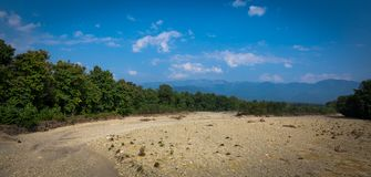 Dry seasonal River bed. Landscape of deep Lake covered with rocky terrain Royalty Free Stock Images