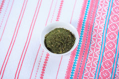 Dry seasoning fennel. In a white plate on a light background Royalty Free Stock Images