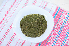 Dry seasoning fennel. In a white plate on a light background Stock Image