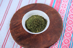Dry seasoning fennel. In a white plate on a light background Royalty Free Stock Photography