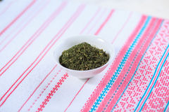 Dry seasoning fennel. In a white plate on a light background Royalty Free Stock Image