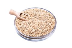 Dry sesame seeds isolated on white background. Isolated bowl of sesame seeds on the withe background with clipping path as package design element and advertising stock images
