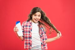 Dry shampoo. Easy tips making hairstyle for kids. Strong and healthy hair concept. Long lasting freshness. Fresh it up. Small child long hair. Girl active kid royalty free stock images