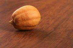 The Dry Single Lemon on the Wood Royalty Free Stock Photo
