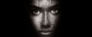 Dry skin concept. Woman with cracked face texture Stock Images